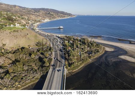 Aerial of Pacific Coast Highway and Malibu Pier in Southern California.