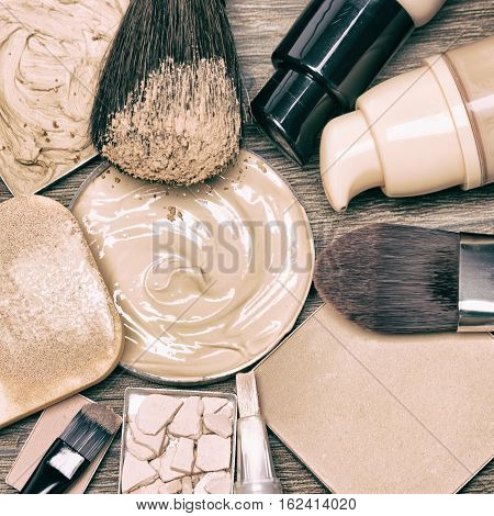 Makeup products to even skin tone and complexion. Corrector, liquid foundation, compact and loose powder with brushes and cosmetic sponge. Retro style processing