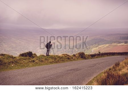 Phtographer In The Mountains