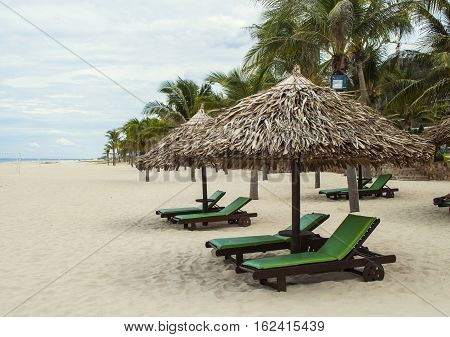 Straw Parasols In The Beach