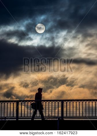 lonely person with clouds and sun