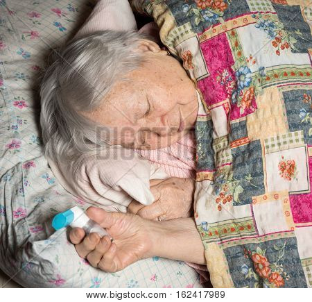 Old Sick Woman With Asthma Inhaler