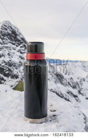 Winter And Thermos In The Mountains.