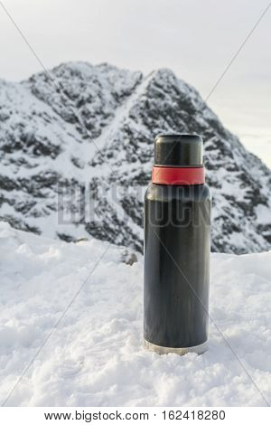 Thermos On Against The Mountain.
