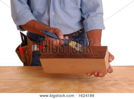 Woodworker Applying Stain