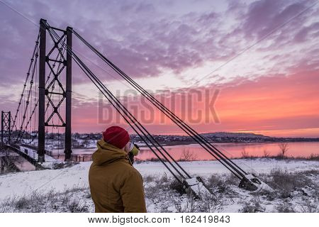 Old bridge in village on sunrise in cold winter day