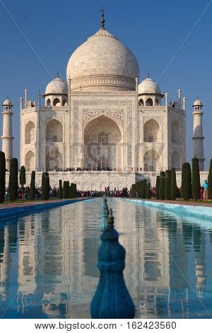 Agra, India - January 26, 2013: Front gate of Taj Mahal with many visitors. Taj Mahal is one of world's heritage by UNESCO.