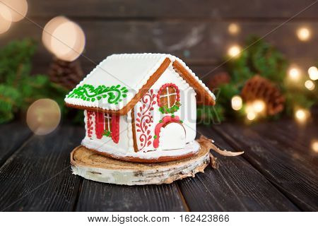 Christmas gingerbread house on wooden table