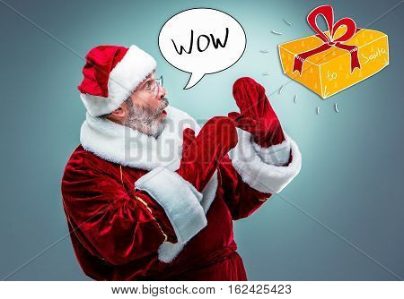 Wondering Santa Claus in profile with a gray beard on a blue background