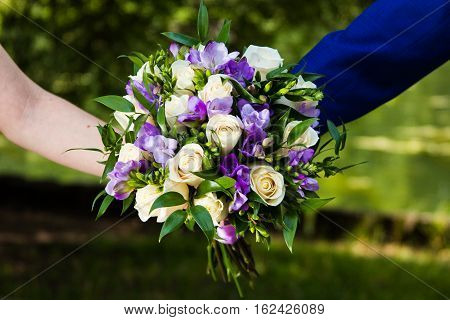 Bridal bouquet. Solemn event.Beautiful bouquet.The bride and groom.