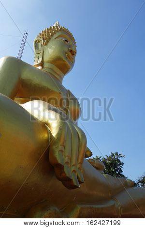 Golden Buddha statue of Big Buddha over blue sky Pattaya Thailand