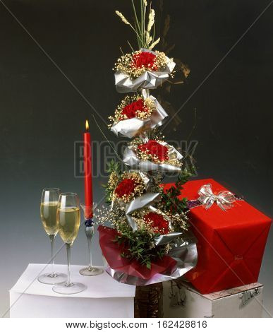 Festive Christmas mood with gifts champagne and candle