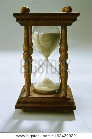 old hourglass made of wood and glass