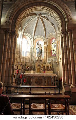 Saint-Laurent-sur-Sevre France - September 10 2019: Figure of Mary in the Basilica of St. Louis de Montfort is Roman Catholic basilica at Saint-Laurent-sur-Sevre France.