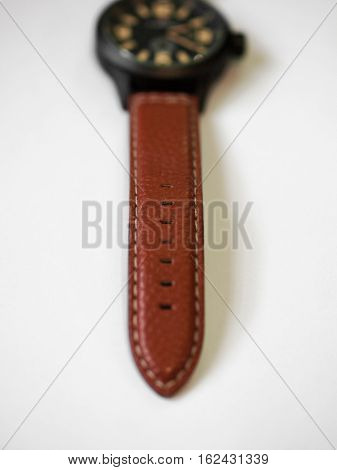 COLOR PHOTO OF BROWN LEATHER WATCH STRAP