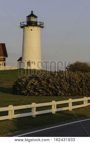 Nobska Point Lighthouse glowing in late afternoon sunlight