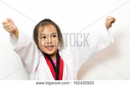 Asian girl is happy she winning Martial Art Competition