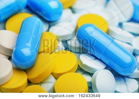 Heap of medicine pills. Background made from the colorful pills and capsules