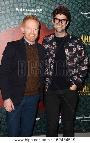 LOS ANGELES - DEC 16:  Jesse Tyler Ferguson, Justin Mikita at the