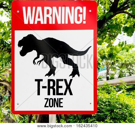 Dinosaur T Rex warning sign in a jungle.