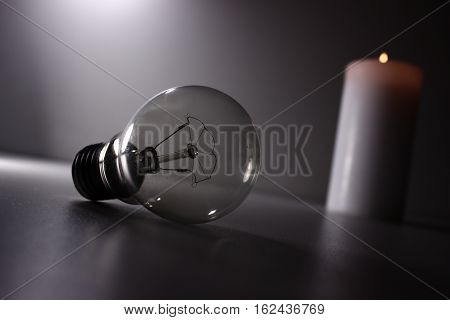 Incandescent and white, a burning candle on a white background