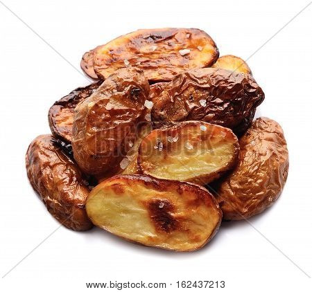 Baked potatoes with salt on white background.