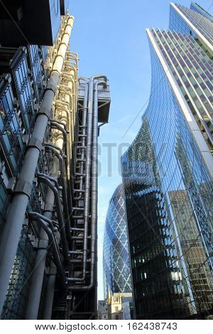 LONDON, UK - JANUARY 25, 2016: The Lloyds Building and Willis Towers Watson Building in the financial district of the City of London with The Gherkin (30 St Mary Axe) in the background