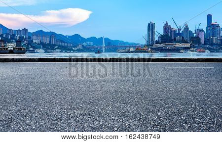 Asphalt road in front of the city skyline Chongqing China.