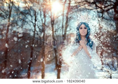 Snow Queen in Winter Fantasy Landscape in Fairy Land