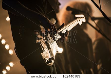 Electric Bass Guitar Player On The Stage