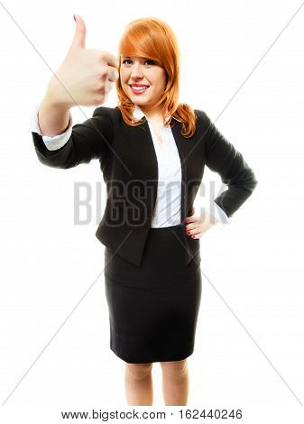 Business gesture and office concept. Attractive redhair smiling businesswoman or student girl giving thumb up sign. Isolated on white background