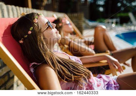 Women Relaxing And Sunbathing In Summer