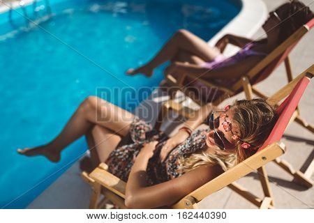 Women Relaxing And Sunbathing In Summer