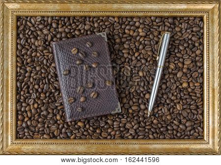 Coffee bean Notepad pen frame from the picture beautiful background view from the side. Business concept.