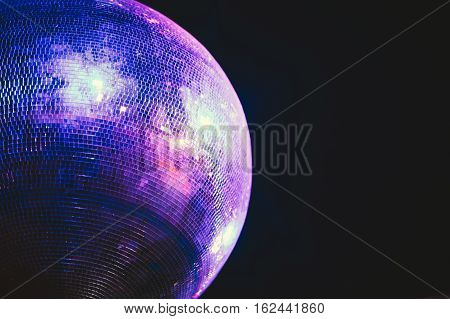 Blue lit disco ball party concept at night