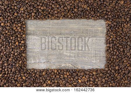 Frame coffee bean with pictures beautiful background view from the side on a wooden table. The concept