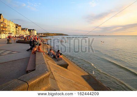 WIMEREUX, FRANCE - AUGUST 26, 2016: The sea front at sunset in Cote d'Opale, Pas-de-Calais