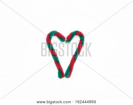 Christmas cane in heart shape isolated on white background