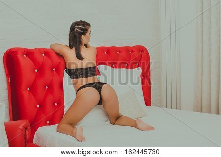 Beautiful sexy woman posing in the bed