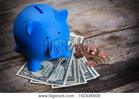 Piggy Bank And Us Dollar Notes And Cents