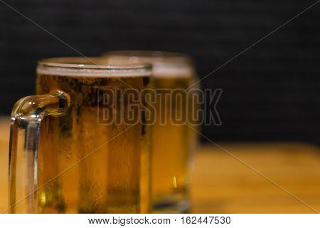 Beer With Ice In Mug Glass