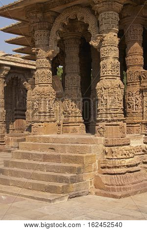 MODHERA, INDIA - NOVEMBER 1, 2007: Ornately carved stonework decorating the Sun Temple at Modhera. Ancient Hindu temple built circa 1027. Gujarat, India.