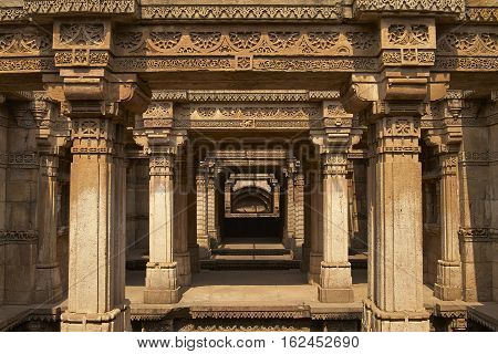 AHMADABAD, INDIA - OCTOBER 30, 2007: Ornately carved stonework of the Adalaj Stepwell on the outskirts of Ahmadabad, Gujarat, India. Built circa 1499.