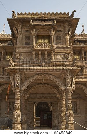 AHMADABAD, INDIA - OCTOBER 30, 2007: Ornately carved stonework of the entrance to the Hutheesing Temple in Ahmadabad, Gujarat, India. Jain temple built circa 1848.