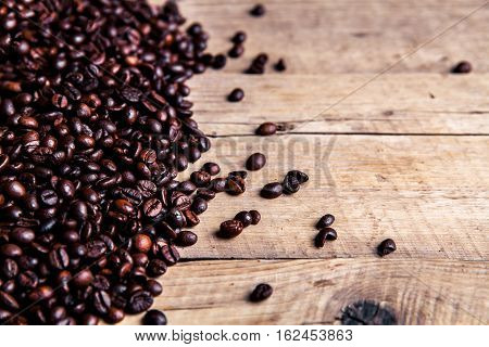 Coffee on grunge wooden background close up