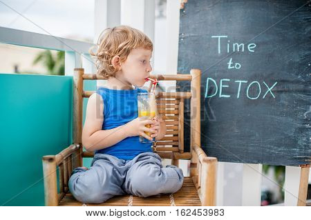Time To Detox Chalk Inscription. The Boy Is Drinking Fresh, Healthy, Detox Drink Made From Fruits. F
