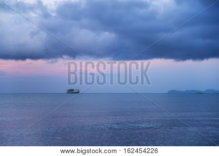 fisherman boat in the sea when sunset sky