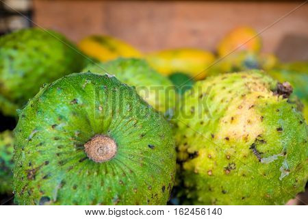 Soursop fruit at asian market or Annona muricata in assortment on sale