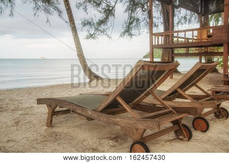 wooden chair for relaxe at beach in Thailand