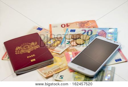 Passport money and phone - ready to go anywhere on white background